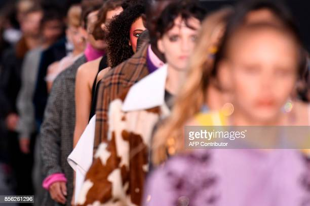 Models take part in the L'Oreal fashion which theme is Paris on the sidelines of the Paris Fashion Week on October 1 on a catwalk set up on the...