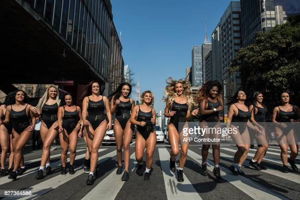 Models take part in the promotion of the Miss Bumbum beauty pageant along Paulista Avenue in Sao Paulo Brazil on August 7 2017 The annual Bumbum...
