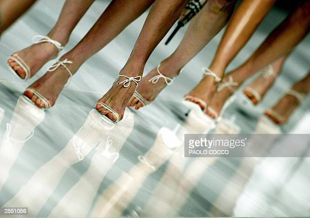 Models take the catwalk at the end of Burberry Prorsum collection shown during Milan's 2004 Spring/Summer fashion week 30 September 2003 The Milan...