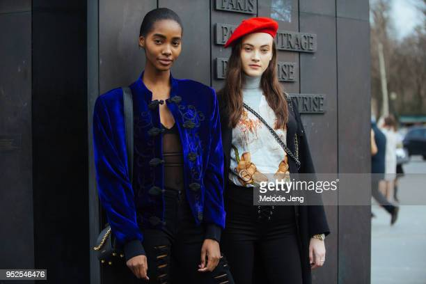 Models Tami Williams Greta Varlese after the Chanel show on March 06 2018 in Paris France Tami wears a blue orientalstyle jacket Greta wears a red...