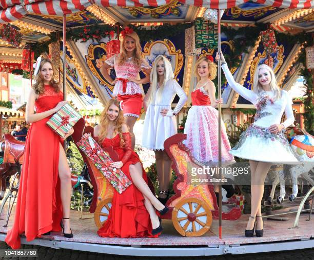 Models Tammy Mea Carena Madeleine Josephine AnneSophie and Isabelle present dresses at the Christmas market in MagdeburgGermany 27 November 2015...