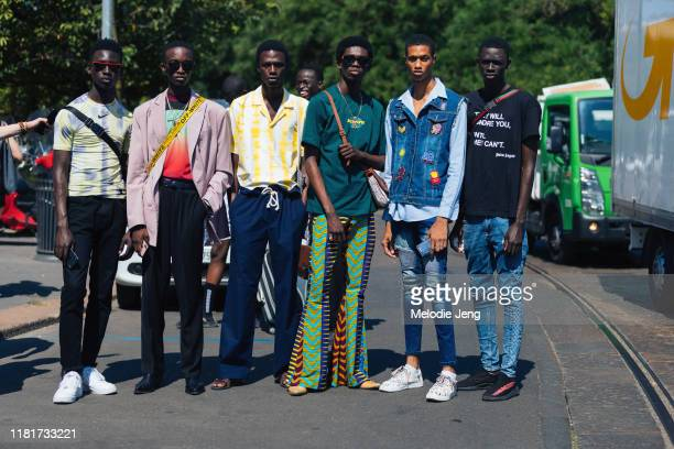 Models Tamsir Thiam, Cheikh Kebe, Cherif Douamba, Ottawa Kwami, Romaine Dixon, and Khadim Sock after the Fendi show during the Milan Men's Fashion...