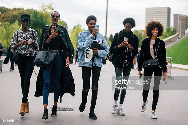 Models Tasha Moore Tara Falla Marie Fofana Melodie Vaxelaire take iPhone photos after the Issey Miyake show on September 30 2016 in Paris France