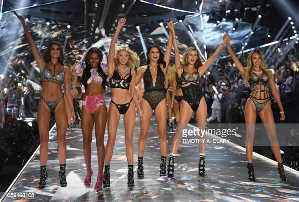 Models Taylor Hill, Jasmine Tookes, Elsa Hosk, Adriana Lima, Behati Prinsloo, and Candice Swanepoe walk the runway at the 2018 Victoria's Secret...