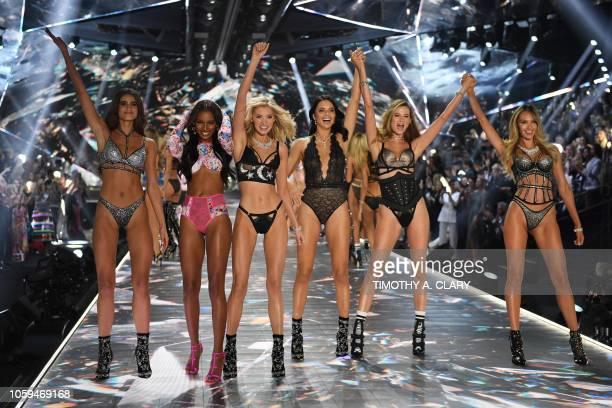 Models Taylor Hill, Jasmine Tookes, Elsa Hosk, Adriana Lima, Behati Prinsloo, and Candice Swanepoel walk the runway at the 2018 Victoria's Secret...