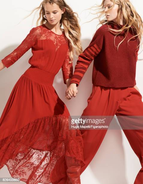 Models Tes Linnenkoper and Hanna Halvorsen pose at a fashion shoot for Madame Figaro on June 30 2017 in Paris France Left Dress earrings boots Right...