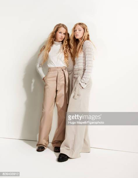 Models Tes Linnenkoper and Hanna Halvorsen pose at a fashion shoot for Madame Figaro on June 30 2017 in Paris France Left Sweater pants shoes Right...