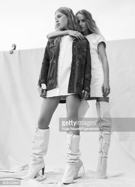 Models Tes Linnenkoper and Hanna Halvorsen pose at a fashion shoot for Madame Figaro on June 30 2017 in Paris France Left Jacket shirt boots Right...