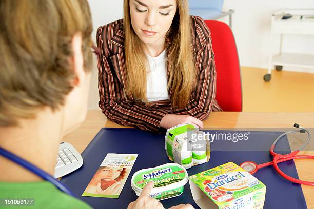 Models The Dietician Is Showing To The Patient Diverse Fuctional Food Of Which Yogurts And Drinking Yogurts Rich In Phytosterols And Margarine Rich...