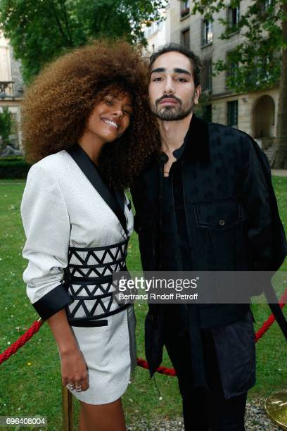 Models Tina Kunakey and Willy Cartier attend the JeanPaul Gaultier 'Scandal' Fragrance Launch at Hotel de Behague on June 15 2017 in Paris France