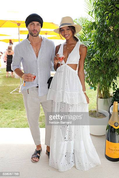 Models Tobias Sorensen and Jasmine Tookes attend the Ninth Annual Veuve Clicquot Polo Classic at Liberty State Park on June 4 2016 in Jersey City New...