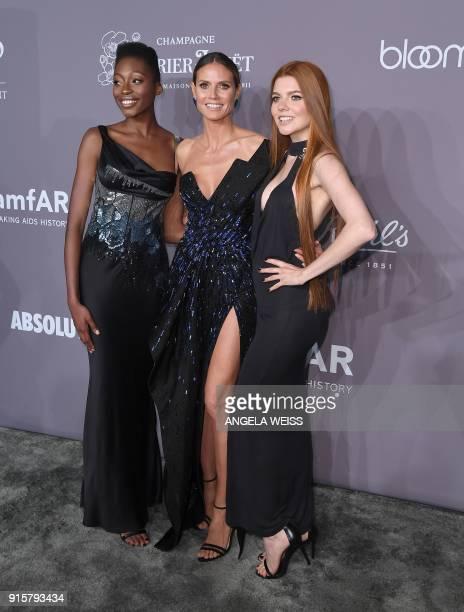 Models Toni Loba Heidi Klum and Barbara Meier attend the 2018 amfAR Gala New York at Cipriani Wall Street on February 7 2018 in New York City / AFP...