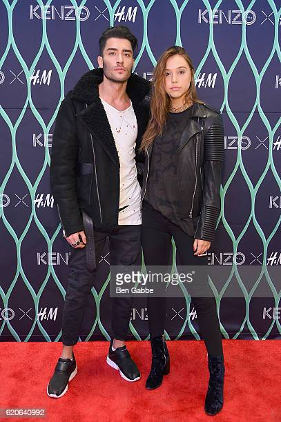 Models Toni Mahfud and Alexis Ren attend Kenzo x HM VIP PreShop Event on November 2 2016 in New York City