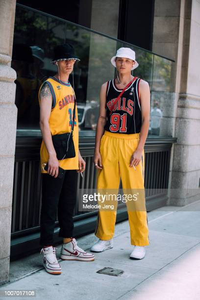 dd79af7e930 Models Tyler Reid Genadij Wilen wear bucket hats and basketball jerseys  during New York Fashion Week