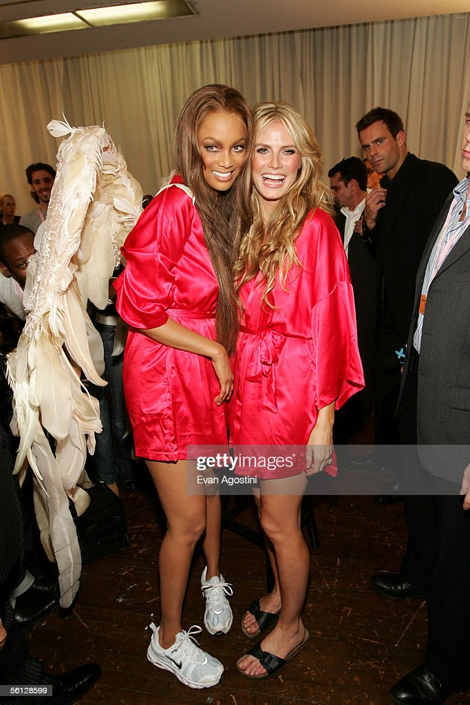 Models Tyra Banks and Heidi Klum pose backstage at The Victoria's Secret Fashion Show at the 69th Regiment Armory November 9, 2005 in New York City.