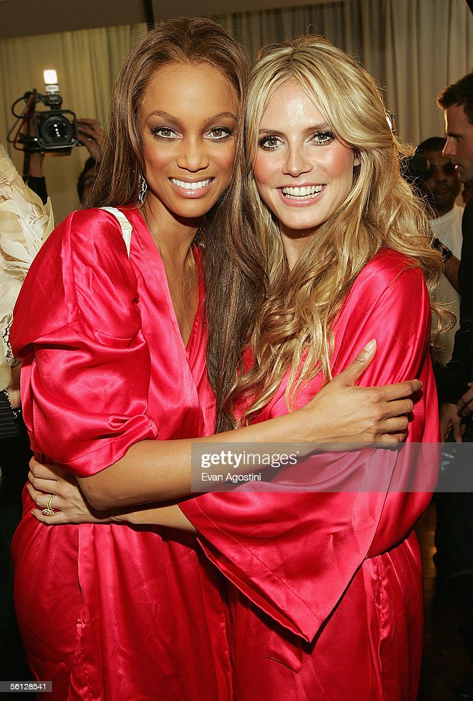 Models Tyra Banks and Heidi Klum pose backstage for The Victoria's Secret Fashion Show at the 69th Regiment Armory November 9, 2005 in New York City.