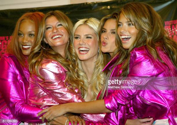 Models Tyra Banks Gisele Bundchen Heidi Klum Alessandra Ambrosio and Adriana Lima pose for photographers before leaving cement handprints at the...
