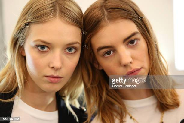 Models Ulrikke Hoyer and Michi Delane prepare backstage at the Zadig Voltaire fashion show during New York Fashion Week at Skylight Modern on...