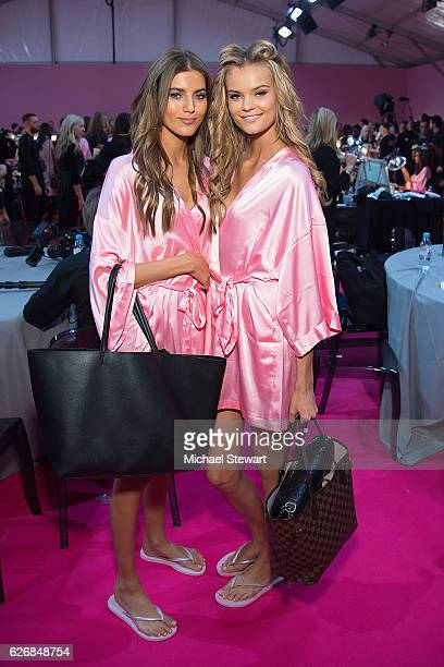 Models Valery Kaufman and Kate Grigorieva prepare before the 2016 Victoria's Secret Fashion Show at Le Grand Palais in Paris on November 30 2016 in...