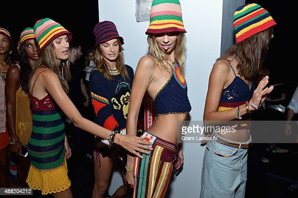 Models Valery Kaufman, Ophelie Guillermand, Lexi Boling, and Pauline Hoarau prepare backstage at Tommy Hilfiger Women's Spring 2016 during New York...