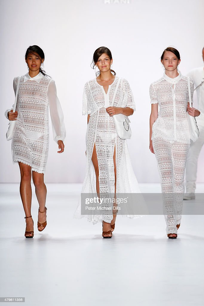 Models Vanessa Fuchs, Anuthida Ploypetch and Ajsa Selimovic walk the runway at the Riani show during the Mercedes-Benz Fashion Week Berlin Spring/Summer 2016 at Brandenburg Gate on July 7, 2015 in Berlin, Germany.