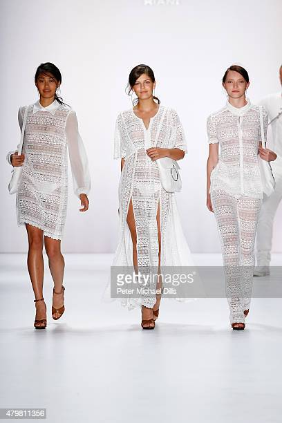 Models Vanessa Fuchs Anuthida Ploypetch and Ajsa Selimovic walk the runway at the Riani show during the MercedesBenz Fashion Week Berlin...
