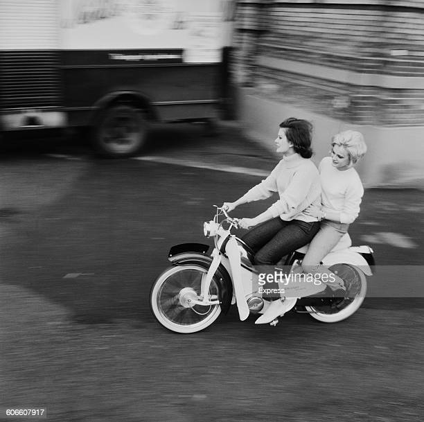 Models Vicky Ward and Sally Foot riding the new Raleigh Supermatic moped UK 9th November 1960