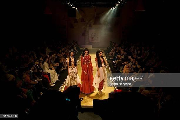 Models Vipasha Agarwal Indrani Dasgupta and Amrit Maghera walk the runway at the Anamika Khanna show during the Lakme India Fashion Week...