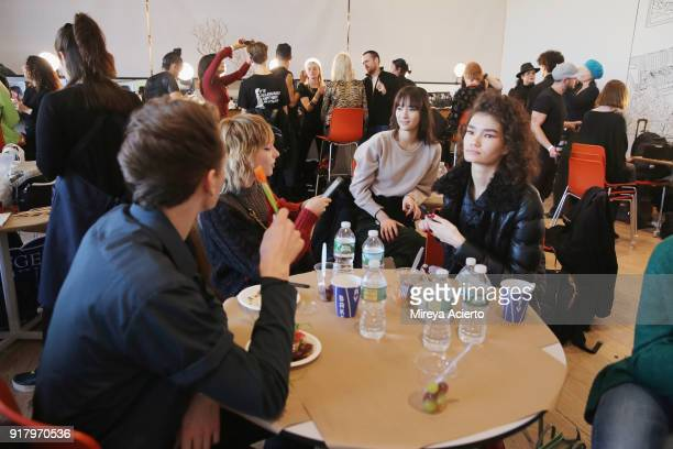 Models wait backstage at the Calvin Luo fashion show during New York Fashion Week on February 13 2018 in New York City