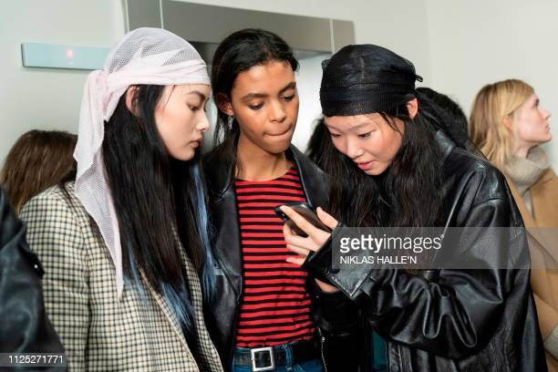 Models wait backstage before a catwalk show by Greek designer Mary Katranzou before her 2019 Autumn / Winter collection catwalk show at London...