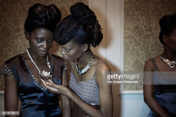 Models wait backstage before a fashion show with a diamond jewelry show on March 21 in Gaborone Botswana The diamond company DeBeers had a fashion...