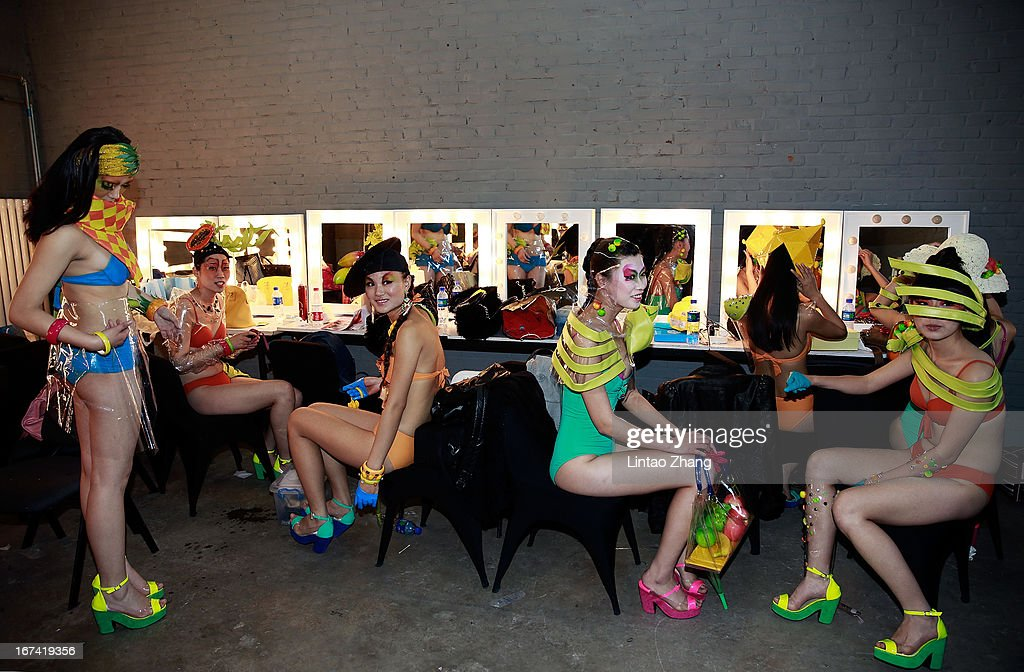 Models wait backstage before during the College of Textiles and Garments,Hebei University of Science and Technology Graduates Show on the second day of China Graduate Fashion Week at 751D.PARK Workshop on April 25, 2013 in Beijing, China.