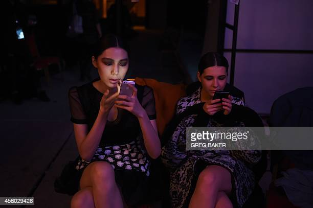Models wait backstage before parading in the Silk Road Costume Sun Xiuqin Collection show at China Fashion Week in Beijing on October 29 2014 AFP...