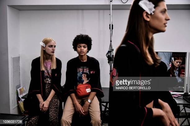 Models wait backstage before presenting creations by Annakiki during the Women's Spring/Summer 2019 fashion shows in Milan on September 19 2018