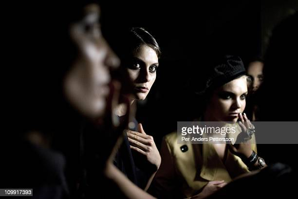 Models wait backstage before shows for the designers Karabo Finger Distinctive Wear Avant at the Joburg Fashion Week on February 18 at the Bus...