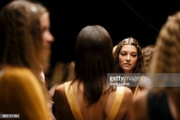 Models wait backstage before the Alice McCall show at MercedesBenz Fashion Week Weekend Edition at Carriageworks on May 19 2017 in Sydney Australia