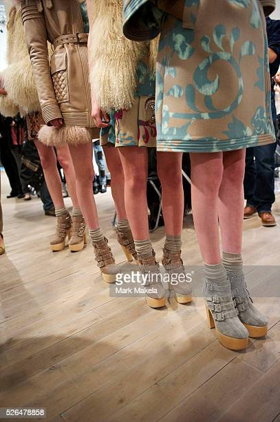 Models wait backstage before the Matthew Williamson autumn 2011 collection at Phillips de Pury Gallery in London on 20 February 2011