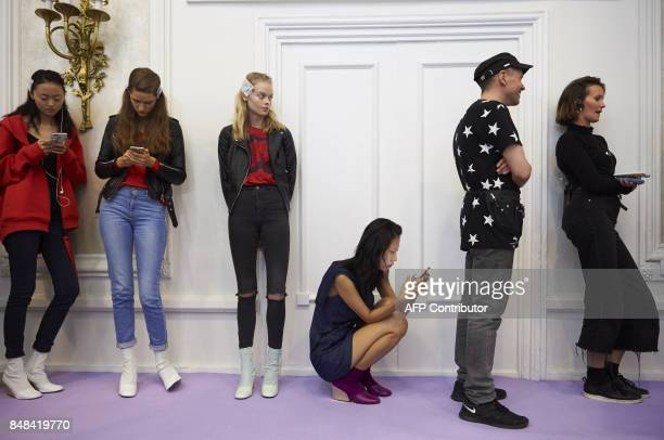 Models wait backstage for a rehearsal ahead of the catwalk show by Peter Pilotto for his Spring/Summer 2018 collection on the third day of The London...