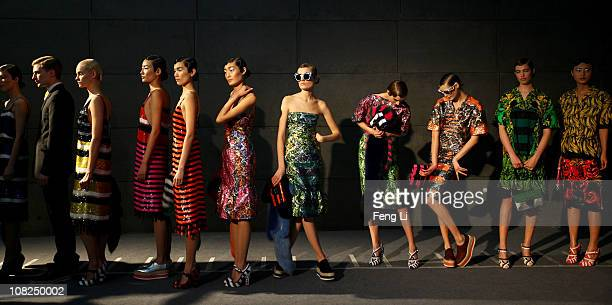 Models wait backstage prior the Prada Spring/Summer 2011 Fashion Show on January 22 2011 in Beijing China