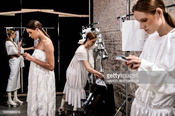 Models wait backstage prior to present creations for fashion house Alberto Zambelli as part of the Women's Spring/Summer 2019 fashion shows in Milan...