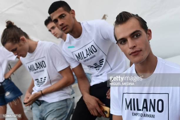 Models wait backstage prior to the presentation of the Emporio Armani fashion house collection as part of the Women's Spring/Summer 2019 fashion...