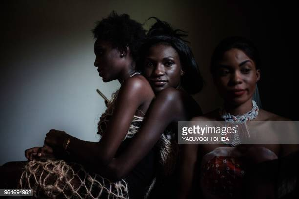 TOPSHOT Models wait before presenting ecofashion using recycled or biodegradable materials during the 'Fashion for Sustainable Future' event by UN...