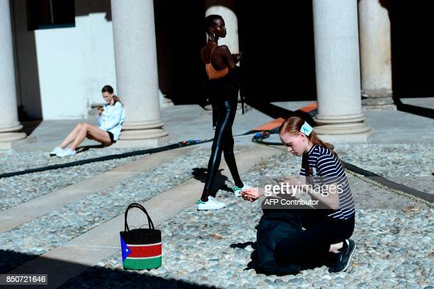TOPSHOT Models wait before the show for fashion house Vivetta during the Women's Spring/Summer 2018 fashion shows in Milan on September 21 2017 / AFP...