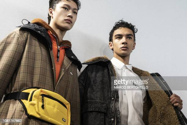 Models wait in the backstage prior to the presentation of fashion house MSGM's Men's Fall/Winter 2019/20 collection in Milan on January 13 2019