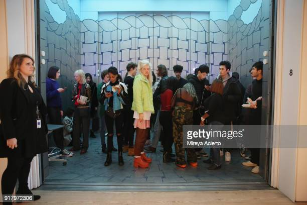 Models wait in the elevator to rehearsal at the Calvin Luo fashion show during New York Fashion Week on February 13 2018 in New York City
