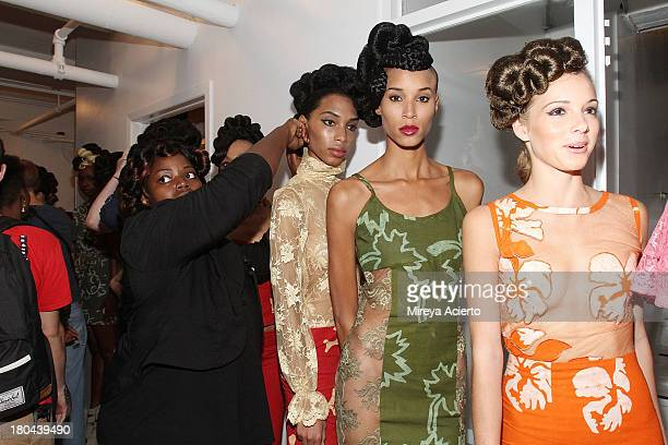 Models wait to enter runway backstage at the St Wobil fashion show during MercedesBenz Fashion Week Spring 2014 at The Designer's Loft at Studio 450...