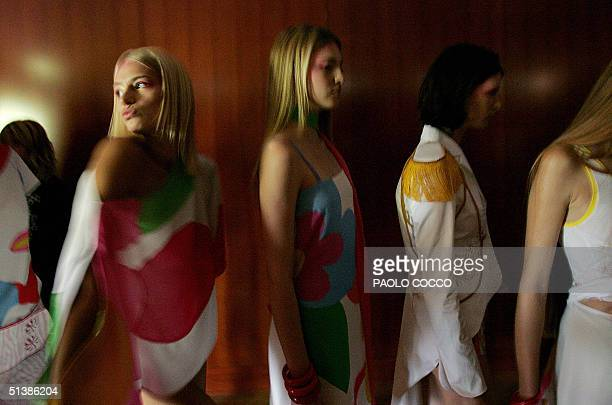 Models wait to enter the catwalk and display Ines Valentinitsch's Spring/Summer 2005 women's collection at Milan's fashion week, 03 october 2004. AFP...
