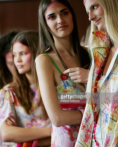 Models wait to enter the catwalk to display Ines Valentinitsch's Spring/Summer 2005 women's collection at Milan's fashion week, 03 October 2004. AFP...