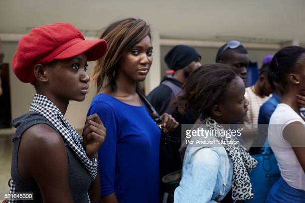Models wait to start fittings and rehearsals a couple of days before Kinshasa Fashion Week on July 16 at Shark club in Kinshasa DRC Local and invited...