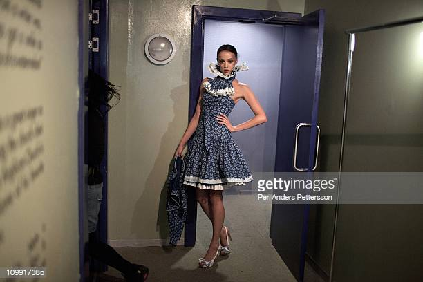 A models waits backstage before shows for the designers Karabo Finger Distinctive Wear Avant at the Joburg Fashion Week on February 18 at the Bus...